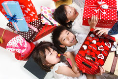 Children holding gift boxes Stock Photography