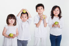 Children holding green apples Royalty Free Stock Image