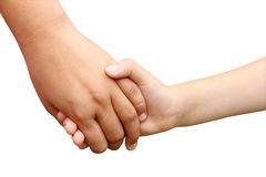 Children Holding Hands. As a symbol of a brother and sister helping each other as siblings or school children in a grasp of unity isolated on white Royalty Free Stock Images