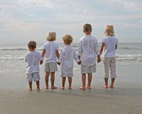 Children Holding Hands at the Beach Royalty Free Stock Photography