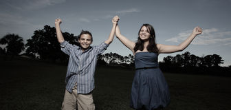 Children holding hands in the park Royalty Free Stock Photography