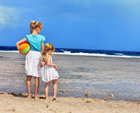 Children holding hands walking on the beach. Royalty Free Stock Photography