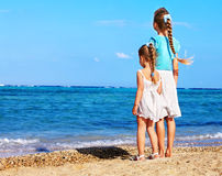 Children holding hands walking on the beach. Stock Photography