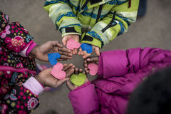 Children holding hearts in hands stock photos