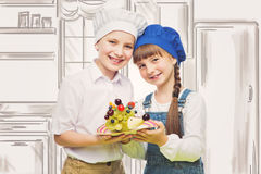 Children holding hedgehog shape fruit snack Royalty Free Stock Photography