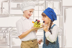 Children holding hedgehog shape fruit snack Royalty Free Stock Photography