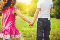 Children holding his hand in summer park outdoor. Stock Images