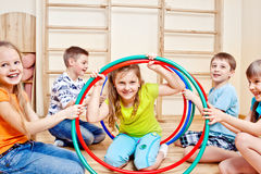 Children holding hula hoops Stock Images