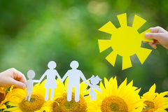 Children holding paper family and sun. Outdoors Stock Photo