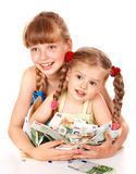 Children holding pile of money. Royalty Free Stock Photography