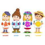 Children holding a sheet of paper with icons of seasons Royalty Free Stock Photos