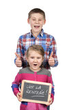 Children holding slate Stock Photography
