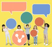 Children holding a speech bubbles royalty free stock photography