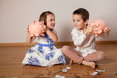Children holding their piggy bank Royalty Free Stock Photo