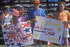 Children Holding Welcome Home Signs Stock Photo