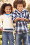 Children Holding Worm Outdoors Stock Photo