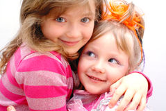 Children on holiday. Two children, beautiful girls sisters at a celebratory party.Isolated on a white background Stock Photography