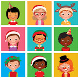 Children in holiday Christmas hats Royalty Free Stock Images