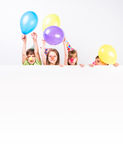 Children with holiday decorations and advertisement blank Royalty Free Stock Photo