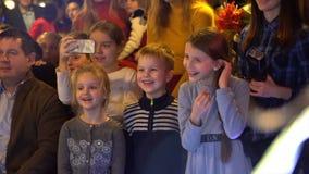 Children on holiday in kindergarten with raised hands. Kyiv, Ukraine 10.05.2019. Children on holiday in kindergarten with raised hands stock video