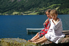 Children on holiday by a lake. Nikon D70, candid portrait of children Royalty Free Stock Photo