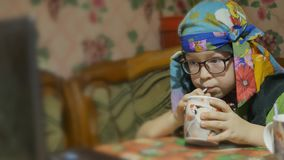 Children at home drinking milk and watch the notebook stock video