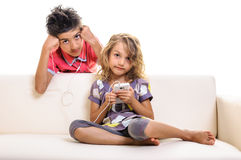 Children at home with smartphone Royalty Free Stock Photos