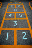Children hopscotch game closeup Stock Photos