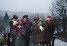 Children huddled in extremely cold weather Royalty Free Stock Images