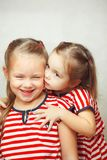 Children hug each other and smile, happy kids stock image
