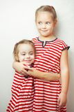 Children hug each other and smile, happy kids royalty free stock photo