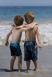 Children hugging on the beach. Stock Photo