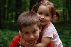 Children hugging each other. Brother and sister hugging each other with love, they are happy Royalty Free Stock Photography