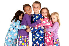 Children hugging in holiday christmas pajamas Stock Photo