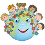 Children hugging planet Earth Stock Image