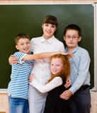 Children hugging their teacher Stock Images