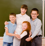 Children hugging their teacher Stock Photos