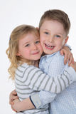 Children hugging on white background Royalty Free Stock Photos