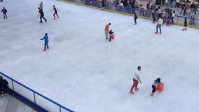 Children ice skating. At AFI Palace Mall ice ring in Bucharest stock video footage