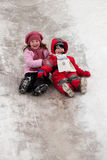Children on icy descent Stock Photos