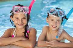 Children In Swimming Pool With Goggles & Snorkel Stock Photography