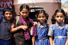 Children in India. Funny schoolchildren on the street of indian city Royalty Free Stock Photo