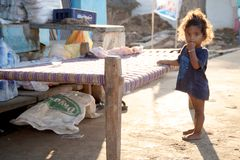 Children of India. Small girl leaning against the bed outdoors in a village, India, ahobilam, Andhra Stock Photography