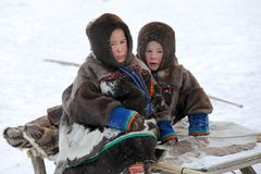 Children of the indigenous people of the Yamal Peninsula Nenets. NADYM, RUSSIA — MARCH 04, 2018: Two boys Nenets during the traditional holiday of the stock photo