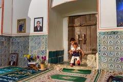 Children inside of Mausoleum of Harun Vilayat, Imamzadeh Haroun-e-Velayat in Imam Ali Square in Isfahan. Iran. Isfahan, Iran - March 21, 2018: Iranian children stock image