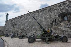 Children inspect military artillery on Gellert Hill in Budapest in Hungary. Stock Photo