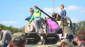 Children inspect and play on military vehicle stock footage