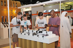 Children inspecting Gun at Abu Dhabi International Hunting and Equestrian Exhibition 2013 Royalty Free Stock Image