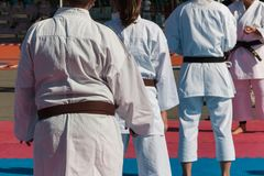 Children with Judo White Uniform doing Public Demonstration Outdoor on Tatami.  stock image