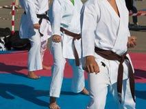 Children with Judo White Uniform doing Public Exhibition Outdoor. Children with Judo White Uniform doing Public Demonstration Outdoor on Tatami royalty free stock photos